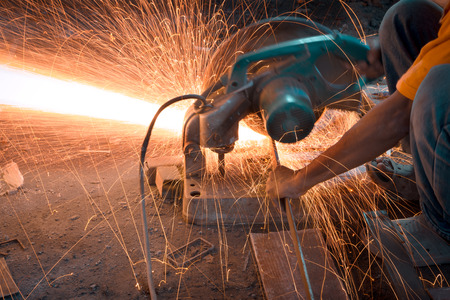 Man cutting and welding at work shop photo