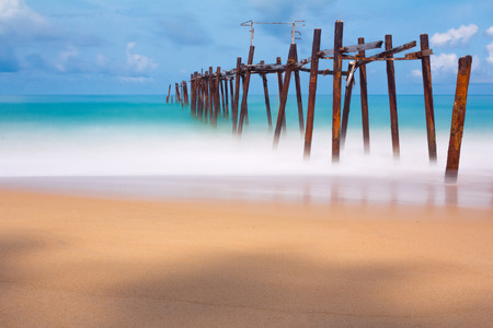 arbor: Day Long exposure old Wood bridge with blus sea and soft sea wave Stock Photo