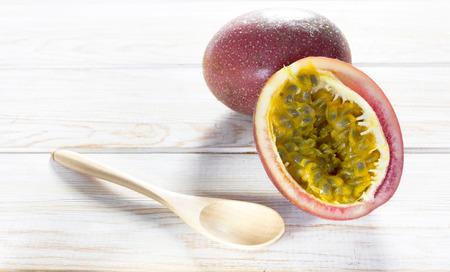 Passion fruit on wood background photo