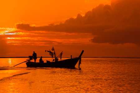 Silhouette of Thai Fishing Boat in South Thailand photo