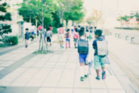 day of school: Group of kids going to school together, motion blurr