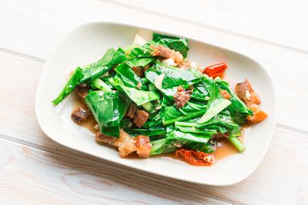 stir fried: Top view, Close up Stir Fried Kale with crispy pork