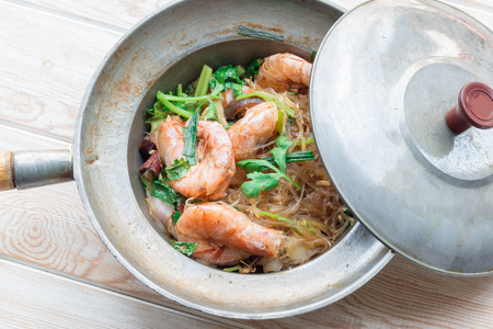 heathy diet: Glass noodles barked with King prawn on wood table