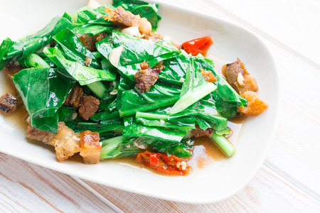 Close up Stir Fried Kale with crispy pork