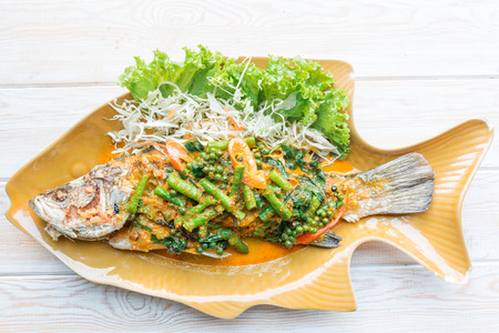 sea bass: Top view, Thai Food - Spicy Sea Bass Soupsteamed, Thai style steamed fish in spicy sauce