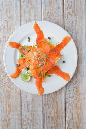 blubber: Top view smoke salmon on wood table Stock Photo