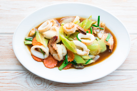 stir: Top view - Fried mix seafood with oyster sauce and green pepper Stock Photo