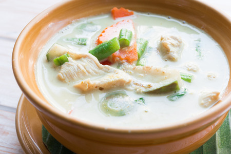 Close up Thai green curry intense soup with chicken Stock Photo