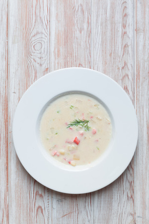 Top view - Salmon cream soup on wood table photo