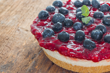 blueberries: Strawberry cheese pie with fresh blueberry on wood