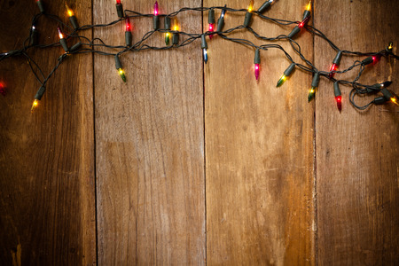 christmas  eve: Top view, Christmas and New Year lights on old wood background