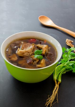 teh: Top view, stew of pork and herbal soup, ba kut teh on black backgroud