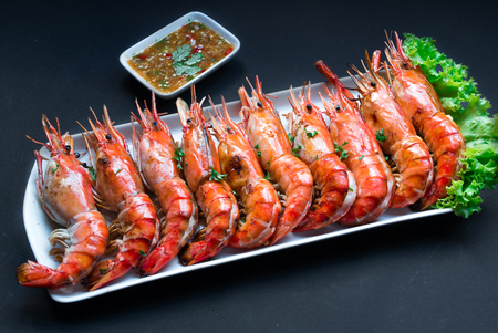 dish: Grilled Giant River Prawn on black background Stock Photo