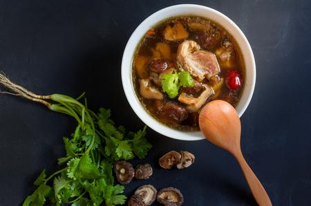 teh: stew of pork and herbal soup, ba kut teh on black background