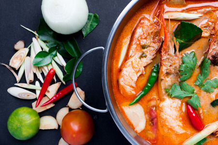 Tom Yum Goong,Thai Food on black background Stock Photo