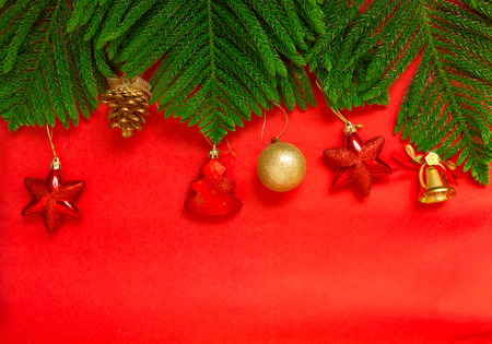 christmas baubles: Christmas tree brach and christmas decoration on red background, christmas background