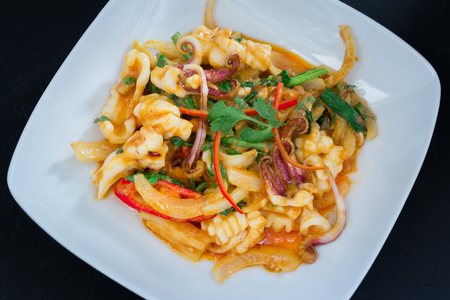 plato de pescado: Stir Fried squid with salted egg york on black background
