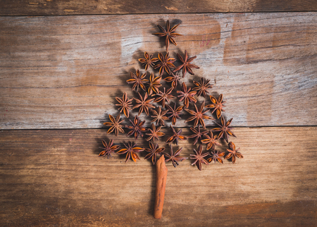 christmas scent: Christmas tree made of cinnamon and anise on old wood Stock Photo