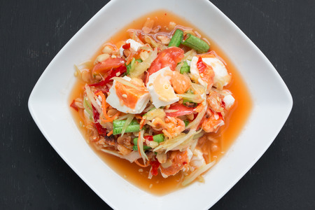green papaya salad: Green papaya salad with salted egg on wood table Stock Photo