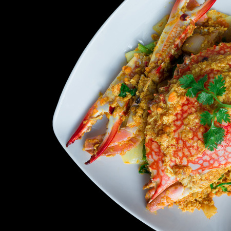 stirred: Stirred Fried Crab with Curry Powder on black background