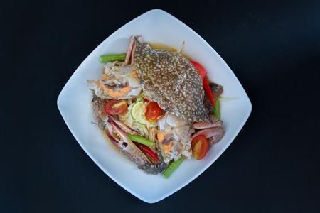 delicious food: papaya salad with crab on black background