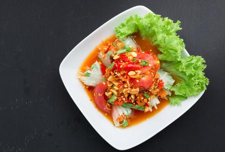 tube top: Famous Thai food, papaya salad tube, top view on black background