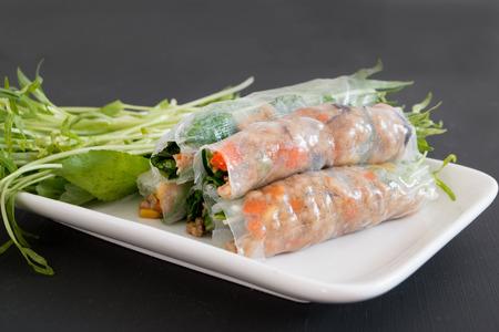 Fresh vegetable noodle spring roll, diet food, clean food, salad on black background