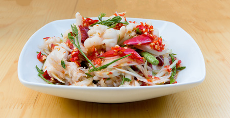 spicy cooking: Green Papaya Salad (Som tum Thai) with mixed vegetable and chicken feet