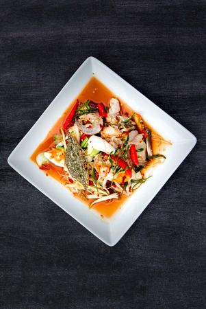 spicy cooking: Green Papaya Salad (Som tum Thai) with seafood, Top view