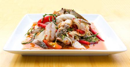 delicious food: Green Papaya Salad (Som tum Thai) mixed with seafood and mushroom