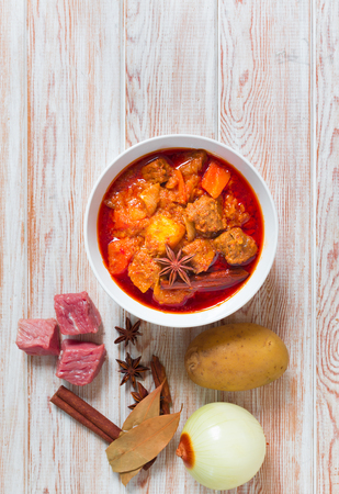 beef curry: Beef massaman curry, top view on wood background Stock Photo