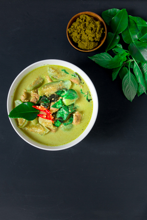 plating: Thai pork green curry on black background Stock Photo