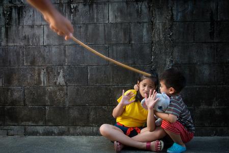 Shot depicting child abuse or punishment