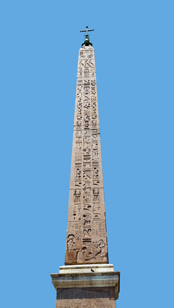 heliopolis: Egyptian Obelisk with star and cross in Piazza del Popolo in Rome Italy