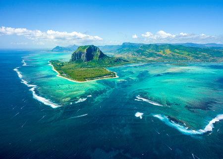 Aerial view of Mauritius island panorama and famous  Le Morne Brabant mountain, beautiful blue lagoon and underwater waterfall