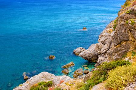 Beautiful summer landscape of the rocky beach in Preveli, Kourtaliotiko Gorge, Crete, Greece