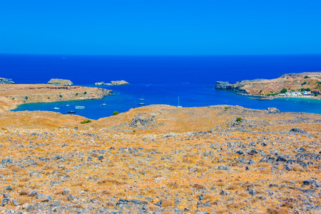 Beautiful summer landscape of the Mediterranean Sea in Lindos bay, Rhodes island, Greece Stock Photo