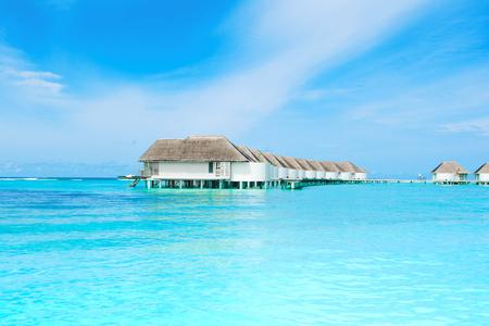 Lhaviyani Atoll, Maldives - 12 July 2018: Beautiful landscape of over water villas in luxury hotel, Kanuhura island Standard-Bild - 113681688