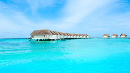 Lhaviyani Atoll, Maldives - 12 July 2018: Beautiful landscape of over water villas in luxury hotel, Kanuhura island Standard-Bild - 113681691