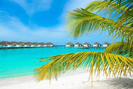Lhaviyani Atoll, Maldives - 12 July 2018: Beautiful landscape of over water villas in luxury hotel, Kanuhura island Standard-Bild - 113681695