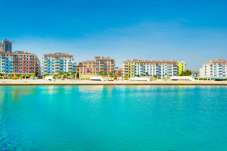 Colorful waterfront buildings in the Qanat Quartier in the Pearl Qatar Standard-Bild - 126027259