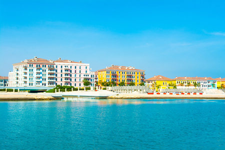 Colorful waterfront buildings in the Qanat Quartier in the Pearl Qatar Standard-Bild - 126027263