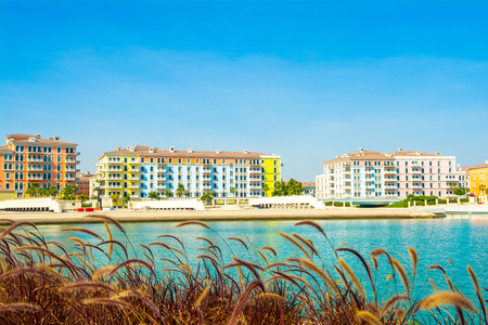 Colorful waterfront buildings in the Qanat Quartier in the Pearl Qatar Stok Fotoğraf