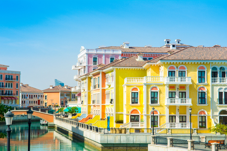 Colorful waterfront buildings in venetian style in the Qanat Quartier, The Pearl Qatar Standard-Bild - 126027326