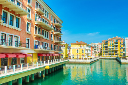 Colorful waterfront buildings in venetian style in the Qanat Quartier, The Pearl Qatar Standard-Bild - 126027390