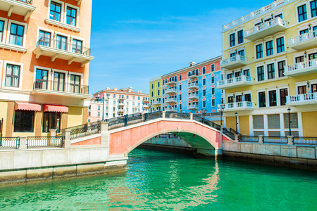 Colorful waterfront buildings in venetian style in the Qanat Quartier, The Pearl Qatar Standard-Bild - 126027393