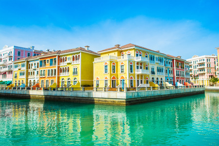 Colorful waterfront buildings in venetian style in the Qanat Quartier, The Pearl Qatar Standard-Bild - 126027664