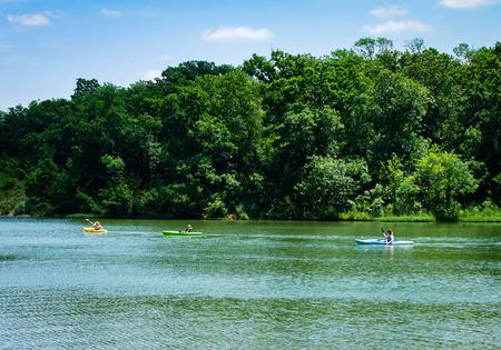 Three people kayaking on a lake