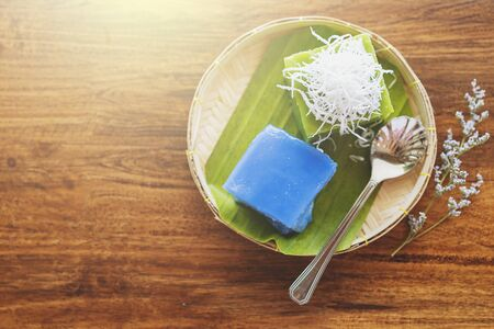 Thai dessert (Khanom Chan) by the window in coffee shop with vintage filter. Top view.