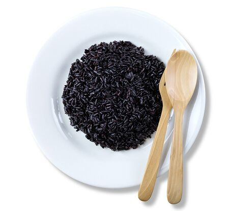 Rice berry or black rice in a white ceramic dish, Agriculture crops in Asia. isolated on white background. with clipping paths.